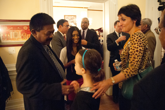 Jaliya Wickramasuriya, Sri Lanka's ambassador to the United States, and his daughter Sarindee (background) chat with Sofia Blake, who is married to Robert Blake, Assistant Secretary of State for South and Central Asian Affairs, and daughter Zara Blake, foreground. The Blakes, who lived in Sri Lanka when Robert Blake served as U.S. ambassador there, were attending the party to celebrate the publication of Rice and Curry, Sri Lankan Home Cooking.